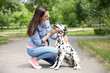 Owner with her dalmatian dog walking outdoors